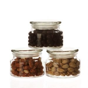 Three glass jars with chocolate and nuts
